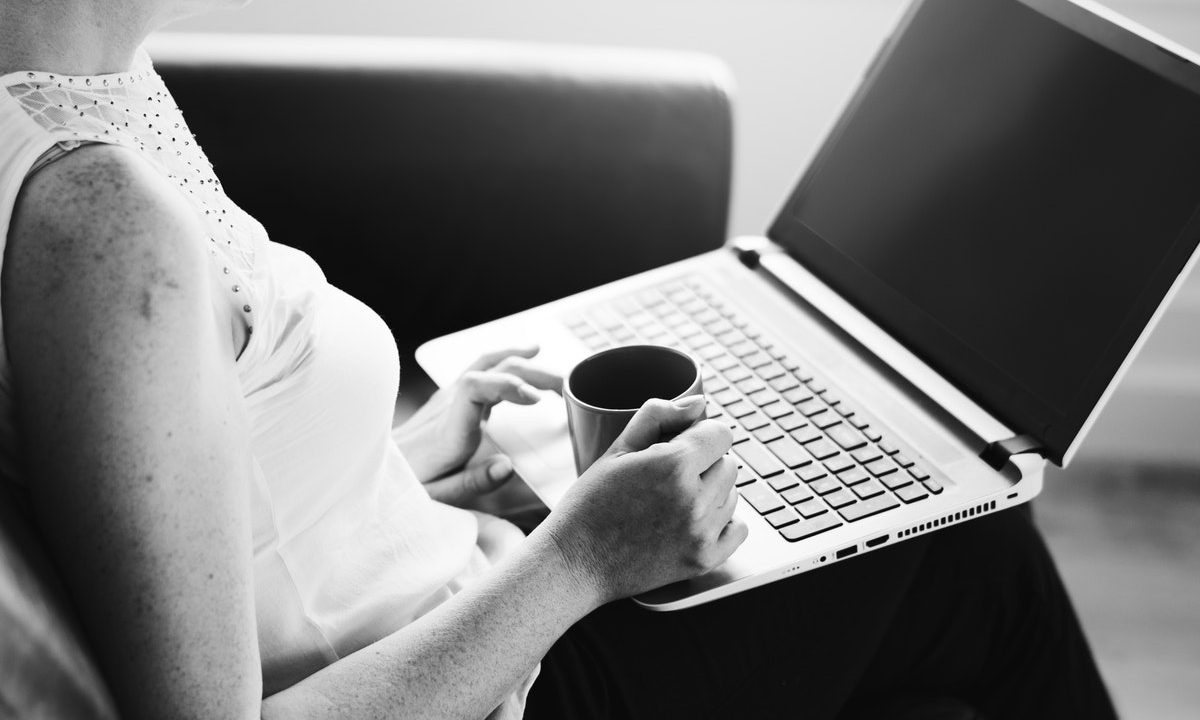 woman with laptop and coffee